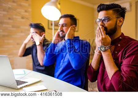 Friends From India Looking Something Interesting On Laptop In Livingroom