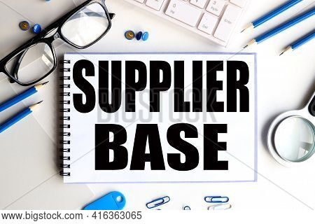 Supplier Base. Text On White Notepad Paper On Light Background.