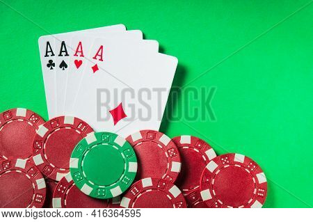 A Poker Game With A Four Of A Kind Or Quads Hand. Chips And Cards On The Green Table. Successful Win