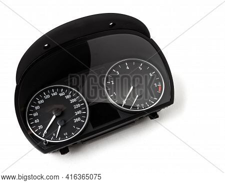 The Dashboard Of The Car With White Arrows With A Speedometer, Tachometer And Other Tools To Monitor