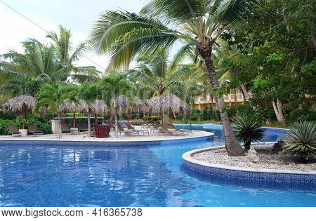 PUNTA CANA, DOMINICAN REPUBLIC - DEC 21, 2016:Pool at Dreams Resort and Spa, Punta Cana in the Dominican Republic. The resort is one of several properties in the AMResorts Collection.