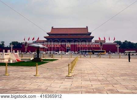 BEIJING, CHINA - JULY 2006: Tiananmen Square, The square contains the Monument to the People's Heroes, the Great Hall of the People, the National Museum of China, and the Mausoleum of Mao Zedong.