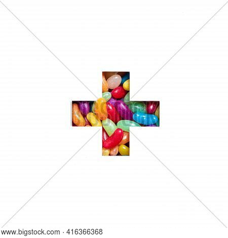 Plus Summation Sign Or Cross Of Colourful Sweet Bonbons And Cut Paper Isolated On White. Candy Typef