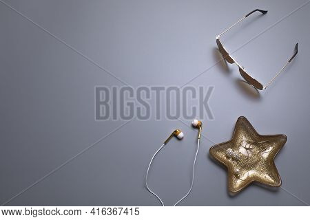 Elegant Background, Template For Text Or Logo. Sunglasses, Earphones And Jewellery On The Grey Backg