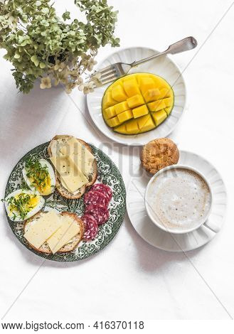 Delicious Brunch - Cappuccino, Fresh Mango, Boiled Egg With Micro Greens, Salami, Cheese Sandwiches