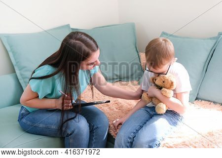 Child Boy In The Psychologists Office. Psychologist Talking To A Child, Student Problems