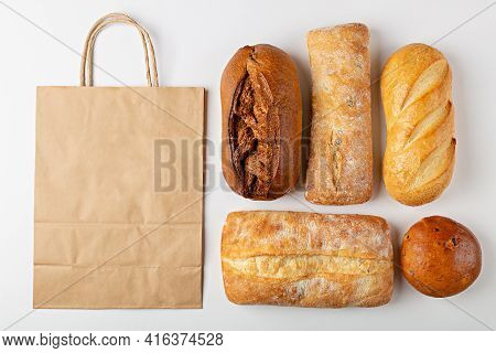 Baking Background With Eco Disposable Paper Bag From A Supermarket Recyclable And Whole Fresh Baked