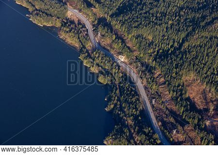 Aerial View From An Airplane Above Of Famous Sea To Sky Highway. Sunny Sunset. Taken In Howe Sound B