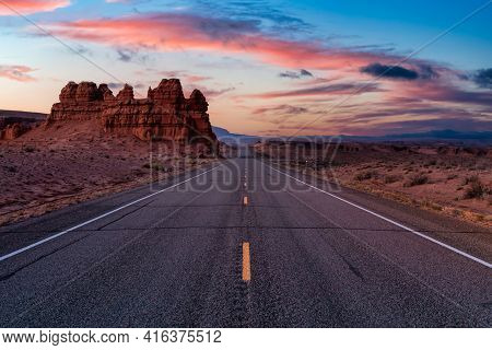 Middle Of The Road View Of A Scenic Route In The Desert. Colorful Sunrise Sky Art Render. Taken On R