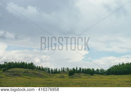 Scenic Green Landscape With Forest Edge On Hills And Beautiful Lenticular Cloud In Cloudy Sky. Atmos