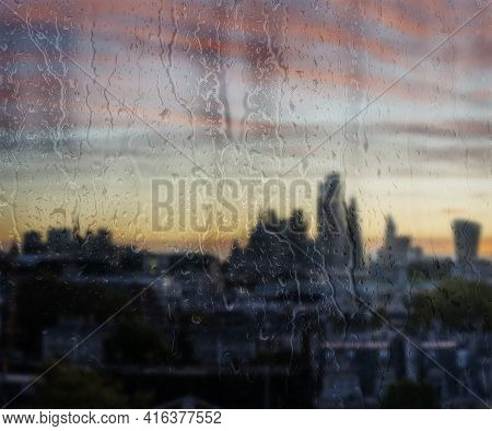 Beautiful Landscape Conceptual View Of London City Through Glass Window With Raindrops Running Down