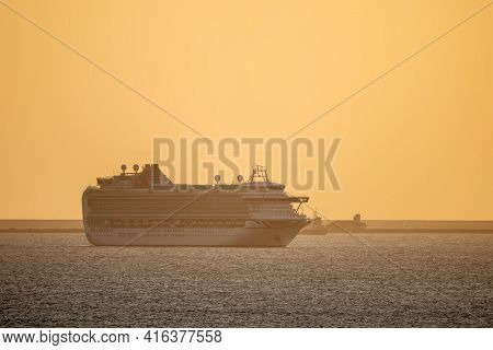 Weymouth, Dorset, 3 April 2021 - P&o Cruise Ship Leaving Weymouth During Glorious Orange Peaceful Su