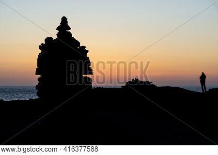 Beautiful Silhouette Landscape Image Of Zen Rock Pile Against Vibrant Peaceful Sunset With Photograp