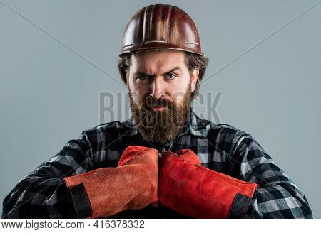 Repairman In Uniform. Guy Builder With Beard And Moustache. Male Foreman In Uniform