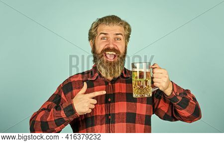 Beer With Foam. Hipster Drink Beer. Mature Bearded Guy Hold Beer Glass. Holiday Celebration. Cheers