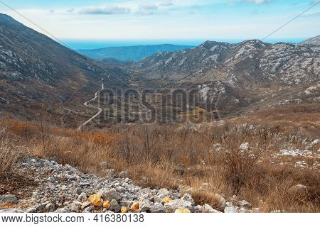 Beautiful Mountain Landscape. View Of Mountain Range And Valley Of Dinaric Alps On Sunny Day Of Earl