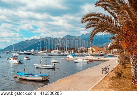Beautiful Mediterranean Landscape With Village Embankment And Fishing Boats On Water. Montenegro, Ad