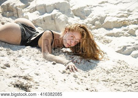 Sexy Summer Girl. Woman Lying In Sand On Beach. Vacation At Paradise. Summetime Mood