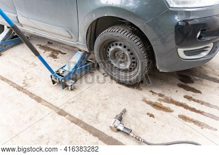 Moscow. Russia. Spring 2020. Car On The Jack Before Replacing The Wheel. Preparing To Replace Winter