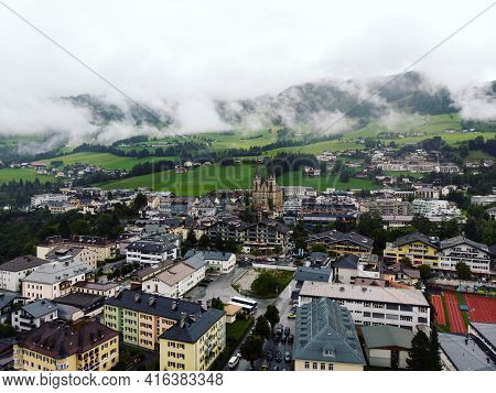 Aerial Panorama View Of Alpine Mountain Town Village City St. Johann Im Pongau With Cathedral Dome I