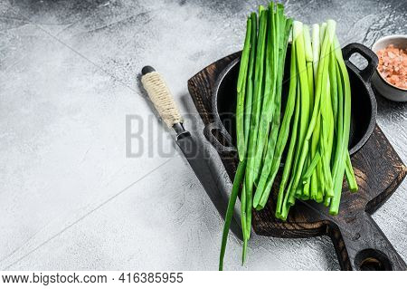Raw Green Onions Chives. White Background. Top View. Copy Space