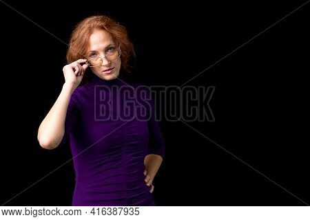 Young Woman Looking Strictly Over Her Glasses