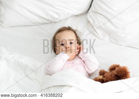 Authentic Portrait Cute Caucasian Little Infant Chubby Baby Girl Or Boy In Pink Sleepy Upon Waking W