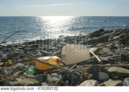 Plastic Fuel Tank Discarded On Contaminated Sea Coast Ecosystem, Environmental Waste Pollution