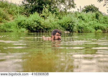 Real Joy. Summer Vacation. Mature Swimmer. Brutal Hipster With Wet Beard. Refreshing In River Water.
