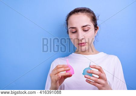 A Shot Of The Menstrual Cup In The Hands Of A Woman. Feminine And Lifestyle. Young Girl And Modern H
