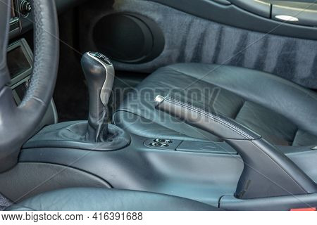 Sports Car Stick Shift 6 Speed Lever Located In Center Console Of Luxurious Interior Of Vehicle.