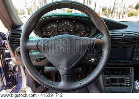 Sports Car Cockpit Is All Controled With The Steering Wheel Of The Drivers Seat.
