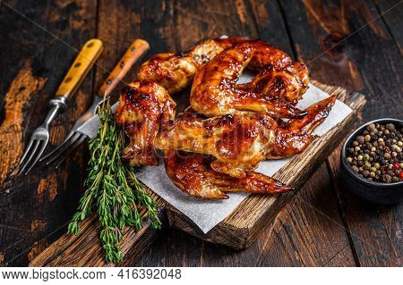 Baked Bbq Chicken Wings With Dip Sauce. Dark Wooden Background. Top View