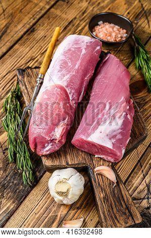 Raw Cut Pork Tenderloin Fillet Meat. Wooden Background. Top View