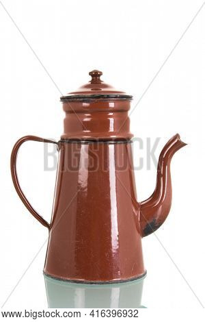 Vintage enamel brown coffee pot isolated over white background