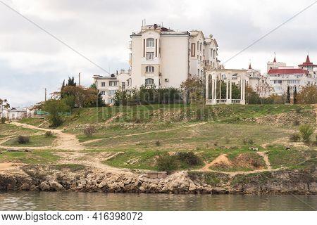 The Embankment In The Streletskaya Bay In Sevastopol. Wild Embankment Near Apartment Buildings.