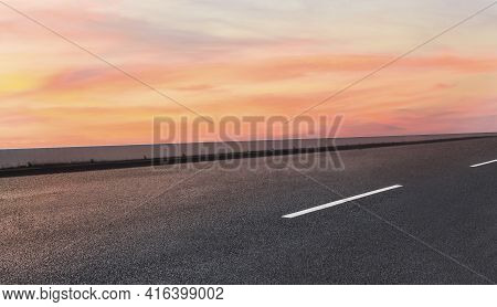 Empty Asphalt Street Road On Highway With Beautiful Sky In Background.