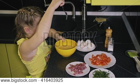 Smart Girl Learning To Cook. Young Mistress Children To Cook A Neapolitan Egg Fried Omelette From Sa
