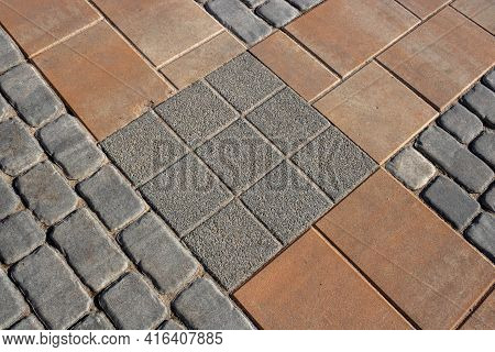 Texture Of Gray And Brown Paving Slabs On The Street, Perspective View. Cement Brick Square Stone Fl