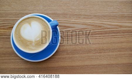 Macro Photo Cup Of Coffe Cappuccino Or Late With Hert On Foam On Wood Tecture Table In Caffe. City B