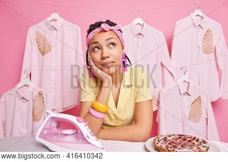 Photo Of Housewife Daydreams About Something Busy Doing Housework Takes Break After Ironing Baked De