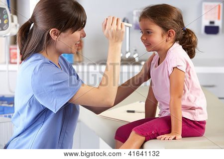 Doctor Examining Child's Eyes In Doctor's Office poster