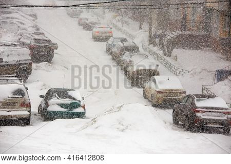 Blizzard At Parking Near Apartment Building In Winter Russia