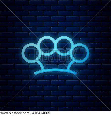Glowing Neon Brass Knuckles Icon Isolated On Brick Wall Background. Vector