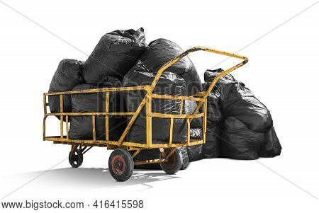 Black Garbage Bags Stack On Trash Pushcart Isolated On White Background With Clipping Path, Environm
