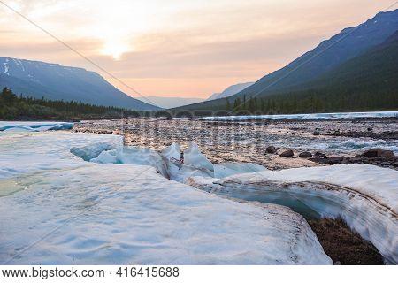 Snow And Ice On The Banks Of The River Hoisey. Putorana Plateau, Taimyr