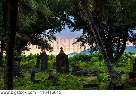 The Old Cemetery Or Pirate Cemetery With Ancient Burials Of The First Settlers In La Digue Island At