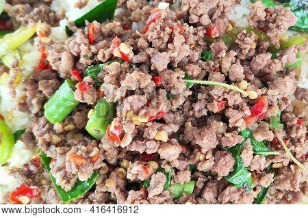 Close Up A Thai Dish Of Basil Fried Rice ,thai Food (pad Kaprao Moo Kai Dao),