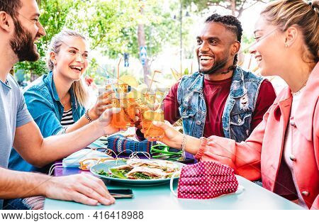 Friends Toasting Spritz At Open Air Cocktail Bar Restaurant - Life Style Concept With Young People H