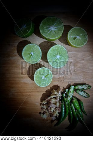 Image Of Sweet Lemon Fruits Sliced And Whole In A Bowl Also Known As Mousambi,musambi,citrus Limetta